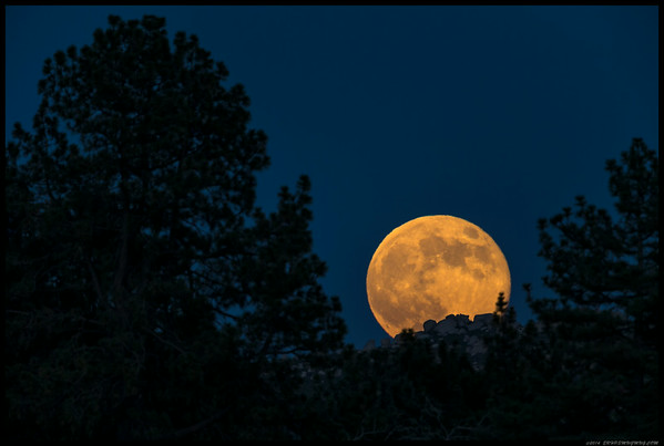 Supermoon rising over one of the rocky ridges between Cuyamaca and Laguna.