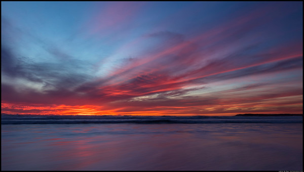 The small clouds on the horizon filtered the light into this display of gossamer threads of color.